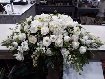 Elegance in white casket spray